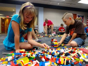 Lynn and Landon pick their Lego blocks from the pile.