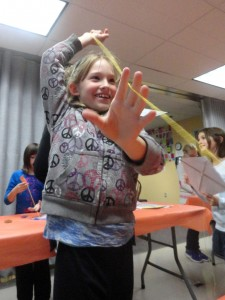Lynn tries to fly her kite indoors during our most recent American Girl Book Club.