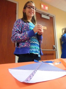 Lindsay designs her paper kite during our American Girl Book Club meeting.