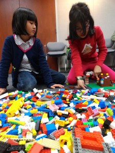 Nicole and Rebecca search our Lego for just the right block.