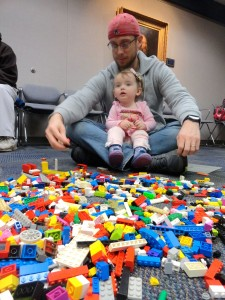 Sophie and John pick their Lego blocks from the pile.