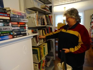 Diane Frangels picks donations from the shelves of our Read House for the Girl Scouts.