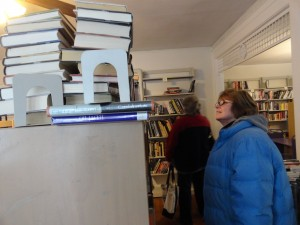 Gail Keegan of Lake-Geauga Recovery Centers looks for books for their clients and children at Lake and Oak House.