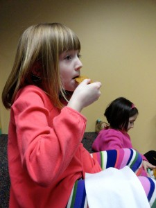 Claire snacks on a gingerbread cookie during our American Girl Book Club meeting.