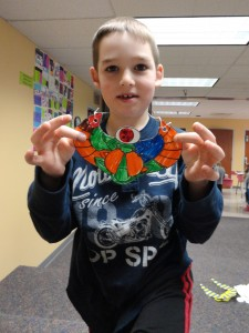 Landon shows off his finished scarab.