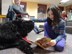 Newfoundland Wilson and Olivia share a book.