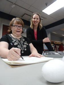 Artist Sandy D'Amico offers some suggestions to to Anne during a Basic Drawing class at Mentor Library.