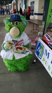 Skipper from the Lake County Captains checks out a book during one of our Flash Libraries.