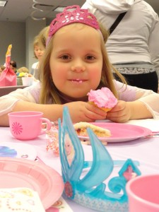Lila coordinates her cupcake with her crown during the princess party at Mentor Library