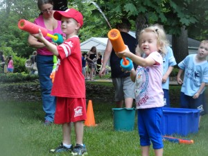 Grant and Linsey take aim at supervillains during our Summer Reading kickoff party.