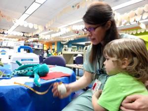 Nurse Amanda makes sure Asher's octopus is doing just fine.