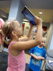 Eva Rajic uses one of the library's iPads to find different constellations.