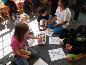 Kids color during Rhyme Time at MPL's Mentor-on-the-Lake Branch.