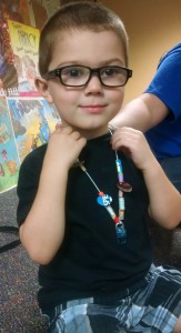 Preston shows off his finished necklace.