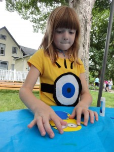 Claire makes a minion while dressed as a minion during our Minions program at Mentor Library. (It's a motif.)