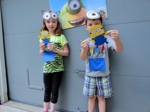 Lillian and Ross show off their finished minions.
