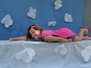 Angelina soars through the air as Captain Underpants during Marvelous Monday at Mentor Library.