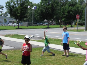 Kids made hoop gliders during the most recent Super Science Saturday.