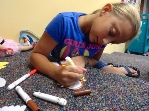 Gabriella decorates her paper doll during the American Girl Book Club meeting at Mentor Library.