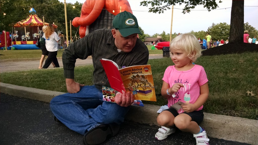 Paulina and her dad visited our Pop-Up Library Friday, and she didn't want to wait to read her new book!