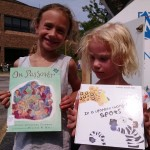 Airyanna and Chloe show us the books the picked from our Pop-Up Library.