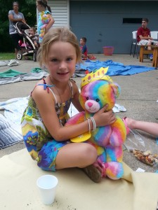 Madelyn gives her teddy bear a squeeze during our picnic.