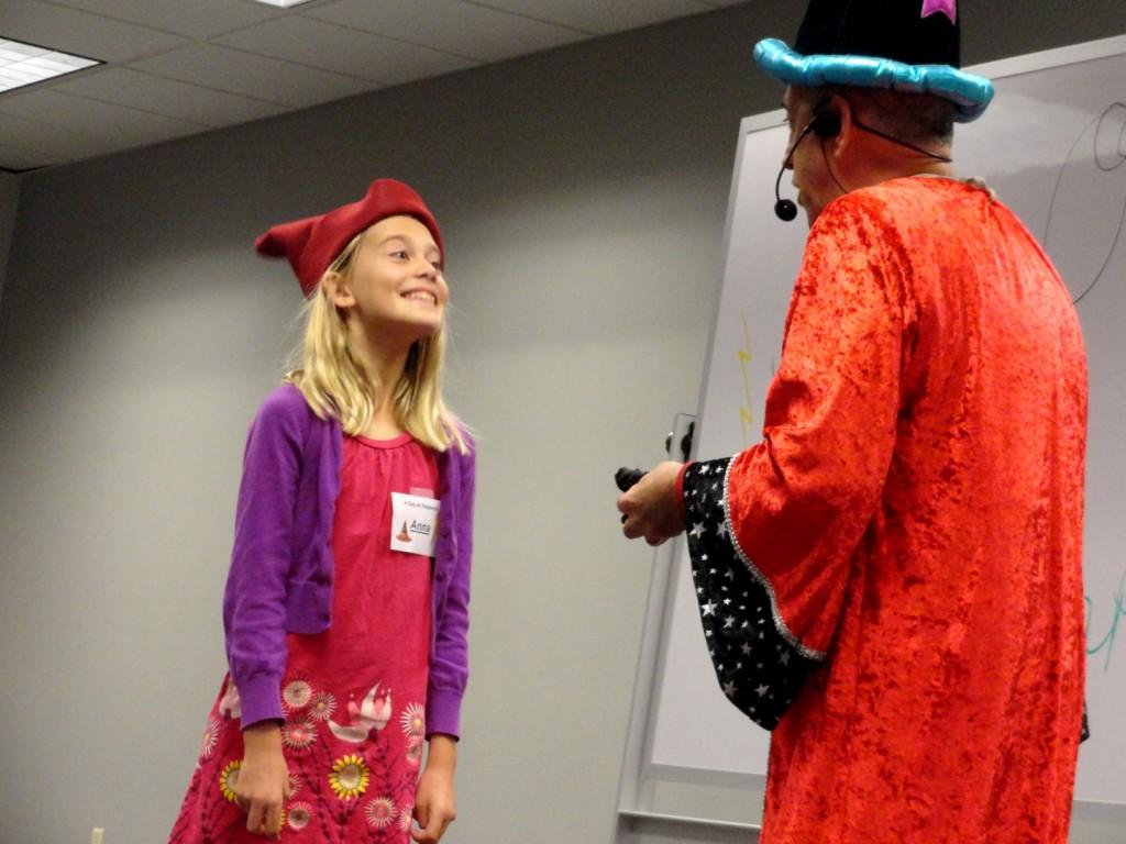Professor Zap shows Anna how a poacher's pouch works.