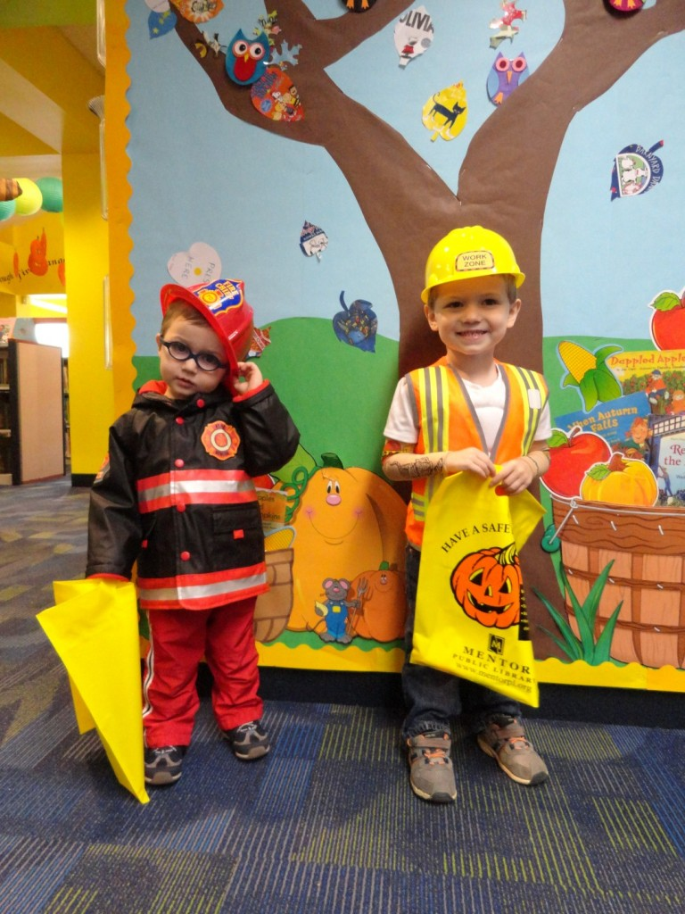 AJ and Bo Brauer dress as civil servants for Halloween.