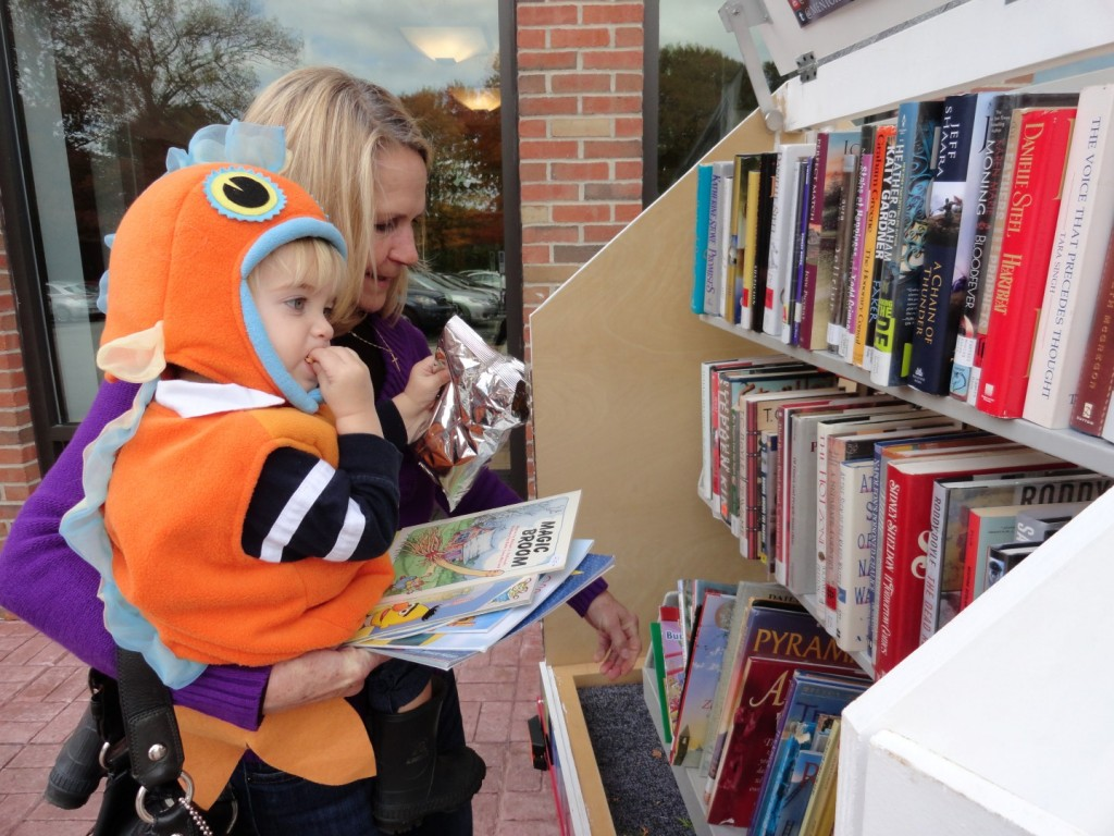 Luke picks a free book or two from Mentor Public Library's Pop-Up Library, because MPL gives away more than candy on Halloween.