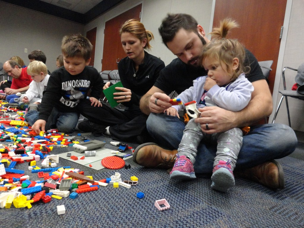 The Dziemianzok family builds as a team during Kids @ Work at Mentor Library.