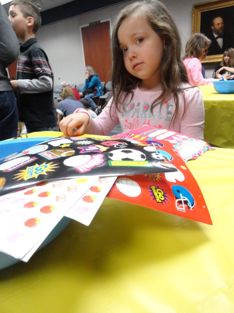 Maddie decorates her name tag during our Peanuts Thanksgiving party.