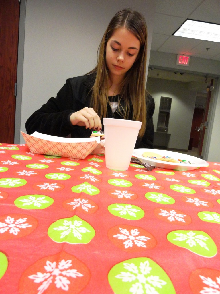Kerri decorates cookies during the Teen Holiday Party at Mentor Public Library.