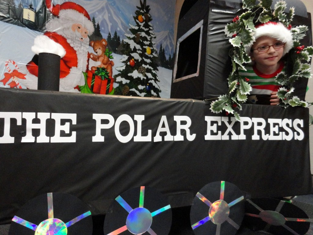 Wyatt takes a ride on the Polar Express at Mentor Library.