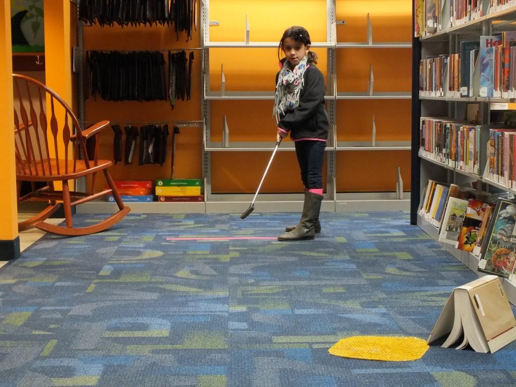 Taryn plays mini golf in our children's department.