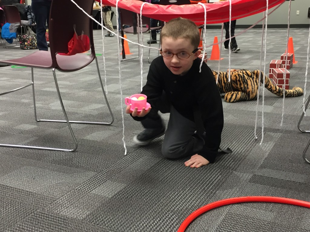 Wyatt balances a cup of tea while running our obstacle course.