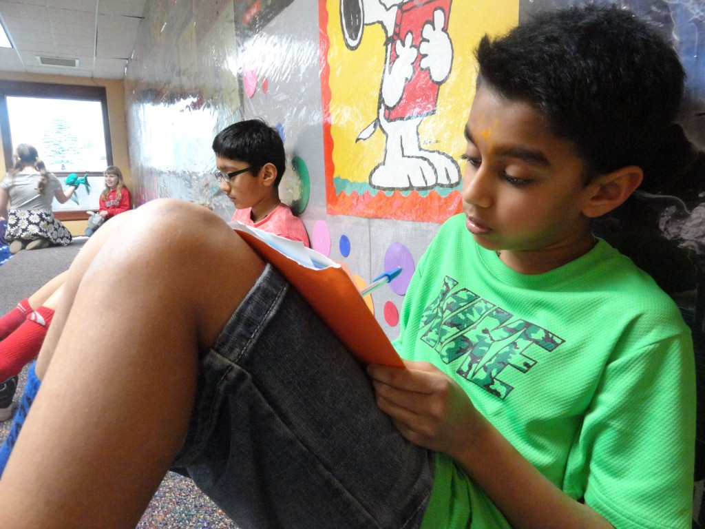 """Darshan and Ahri write using their """"lucky"""" prompt during Mentor Public Library's Wordplay Club meeting."""