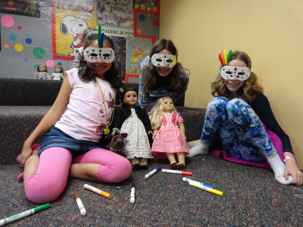 Some of the girls show off their finished masks.