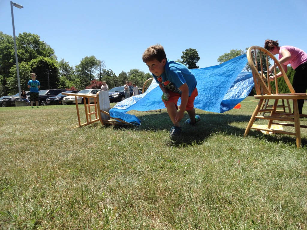 Andrew dips through the tunnel of our Maze Runner obstacle course.
