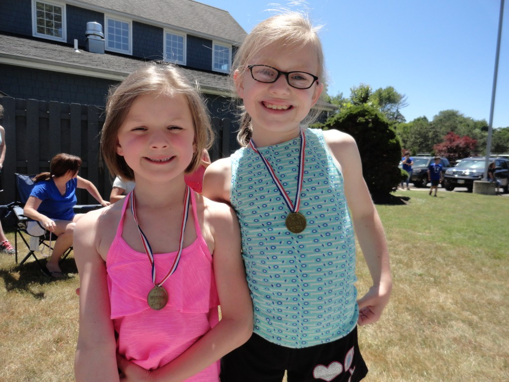 Summer and Julia show off the medals they earned by completing our obstacle course.