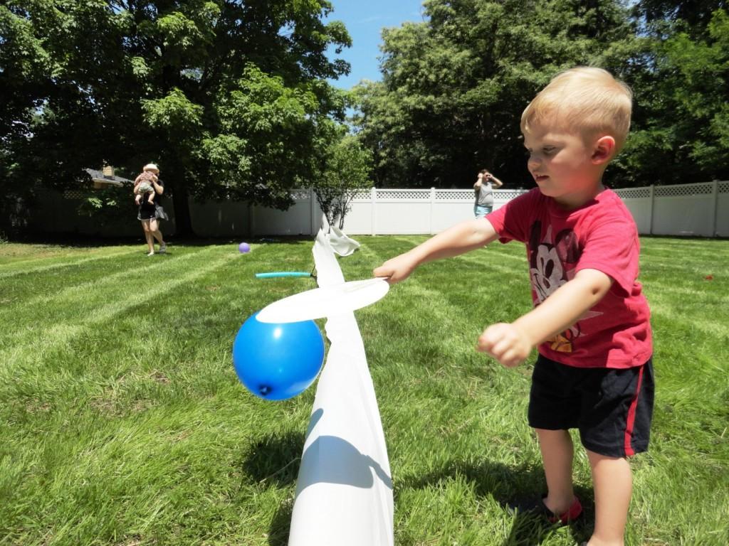 Luka tries out balloon tennis.