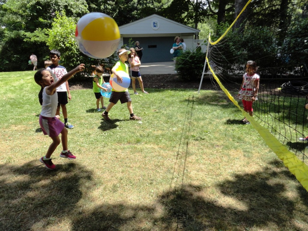 Bryn dives to keep the volley alive during Move-It Monday at Mentor Public Library.
