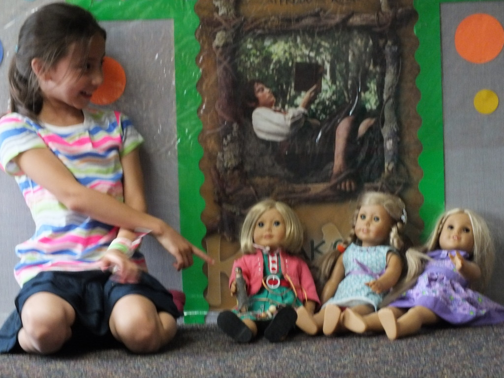 Our of our book-club members gave her doll a doll.