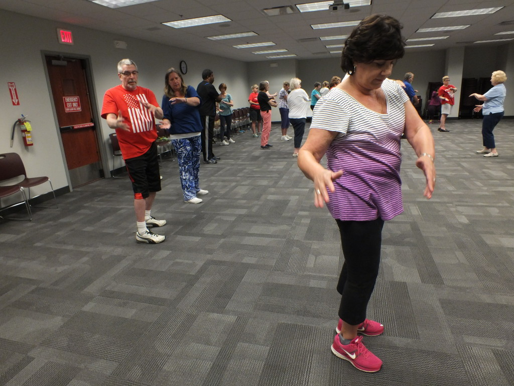 Our patrons try a free Tai Chi class with Libby Hill from Family Karate.