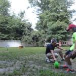 Olivia kicks a field goal.