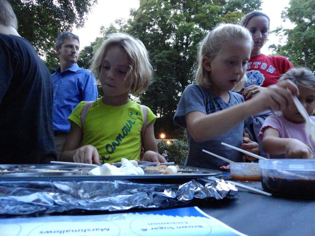 Madelyn and Claire try to decide what campfire snacks they want.