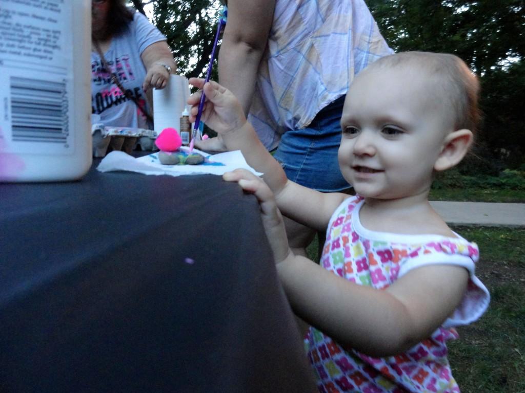 Juniper paints her pet rock.