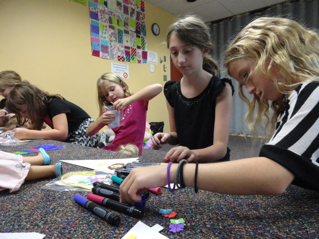 The American Girl Book Club makes kites during their October meeting.