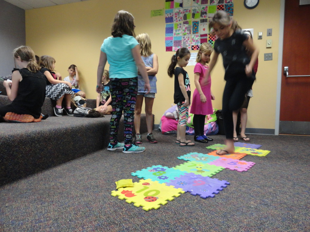 The girls played hop-scotch during the American Girl Book Club meeting at Mentor Public Library.