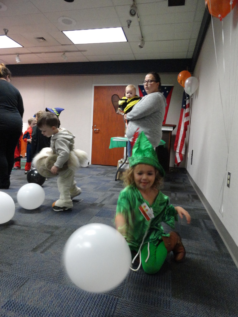 Sienna gets a little distracted from the games by the balloons.