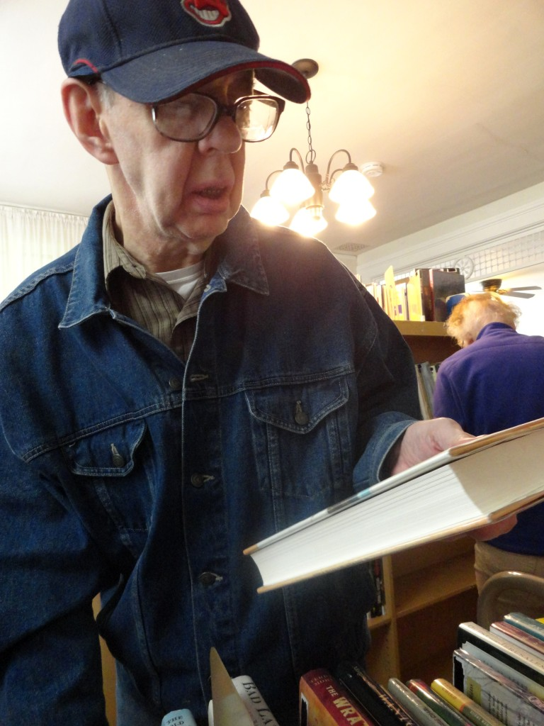 Doug Reed helps shelve books in the house where he used to live. The Read House is now owned by Mentor Public Library.